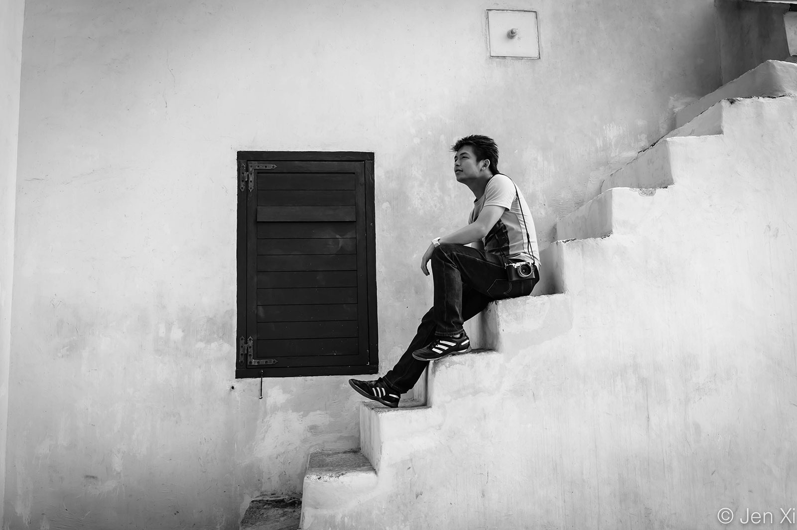 Man sitting on a flight of stairs