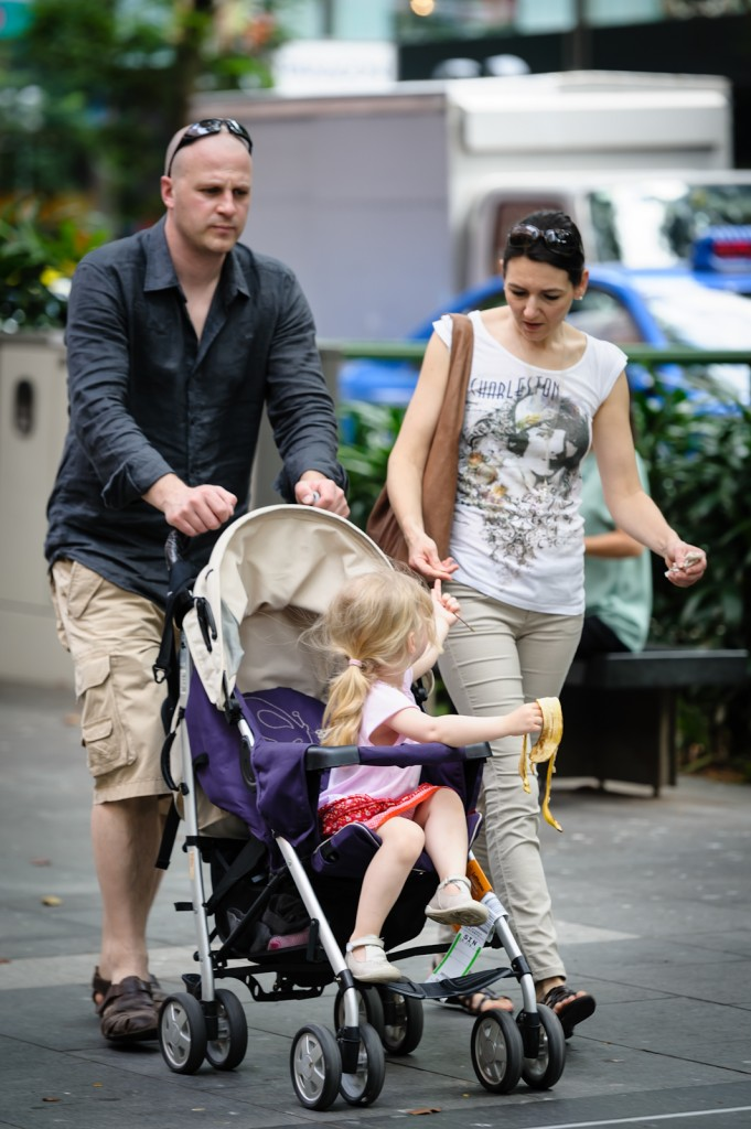 Street photography - Couple with a child in pram