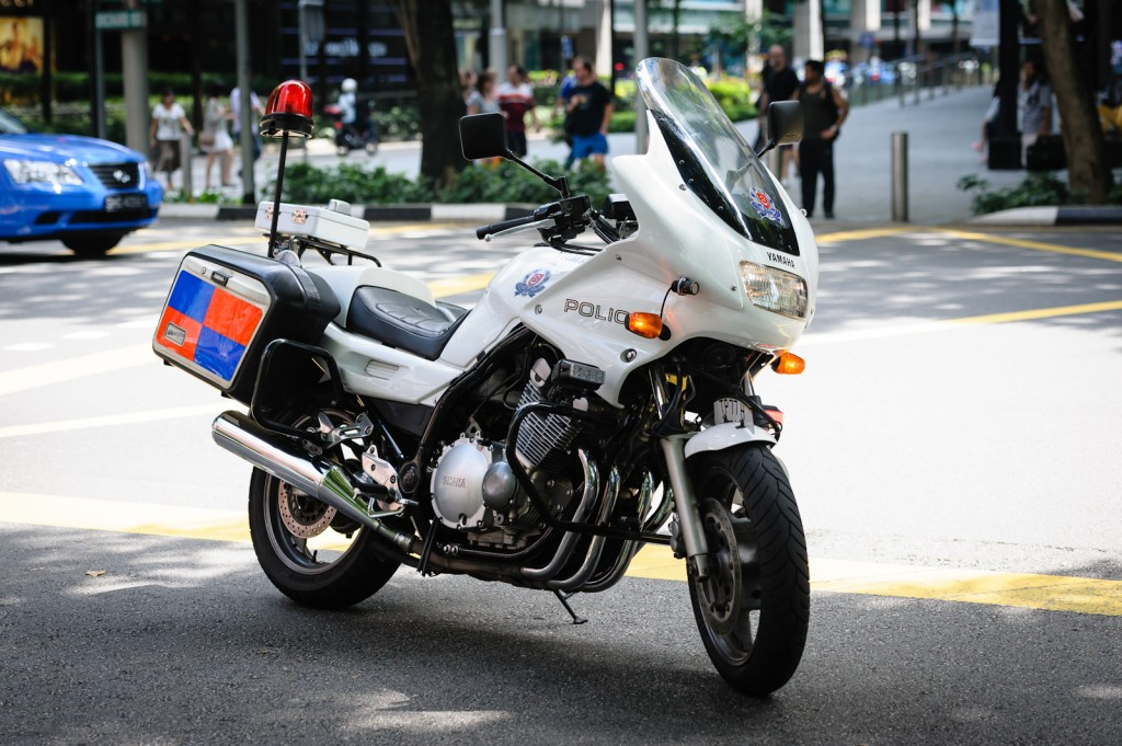 Street photography - Police motorcycle in Singapore