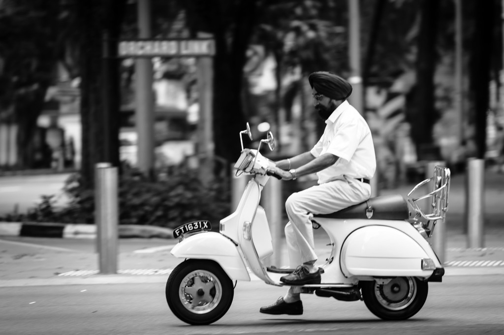 Street photography - A Sikh man on a Vespa in Singapore