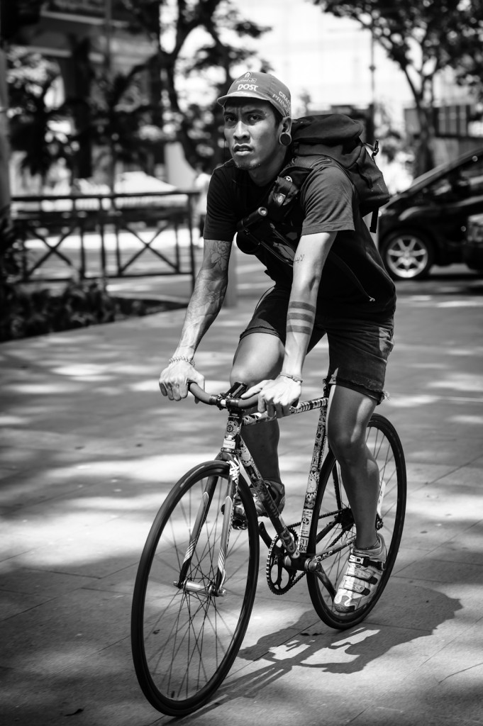Street photography - Man riding a bicycle in Orchard Singapore