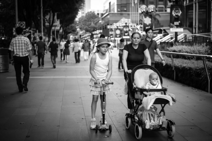 Mother and her two daughters in Orchard Road