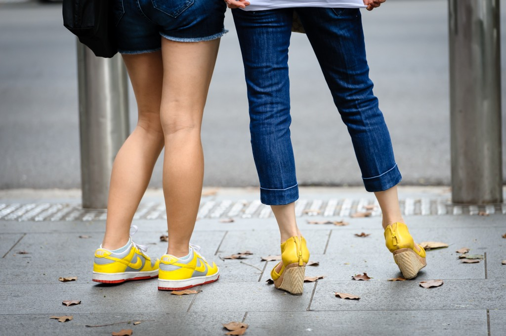 Street photography - denim bottoms and yellow shoes