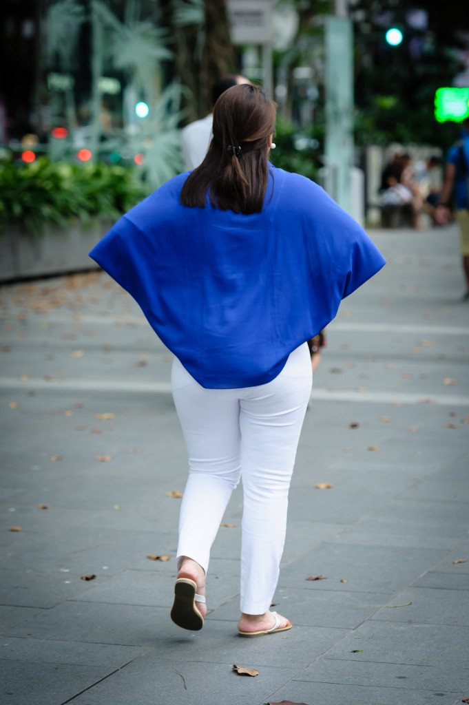 Street photography - Woman in blue top and white pants