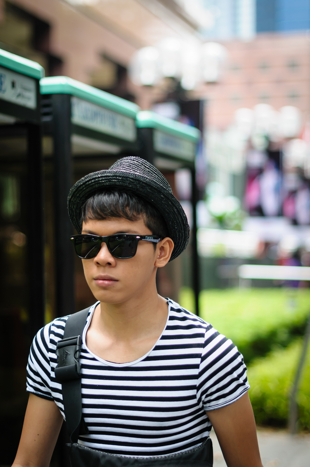 Street photography - man with a hat wearing shades and stripes