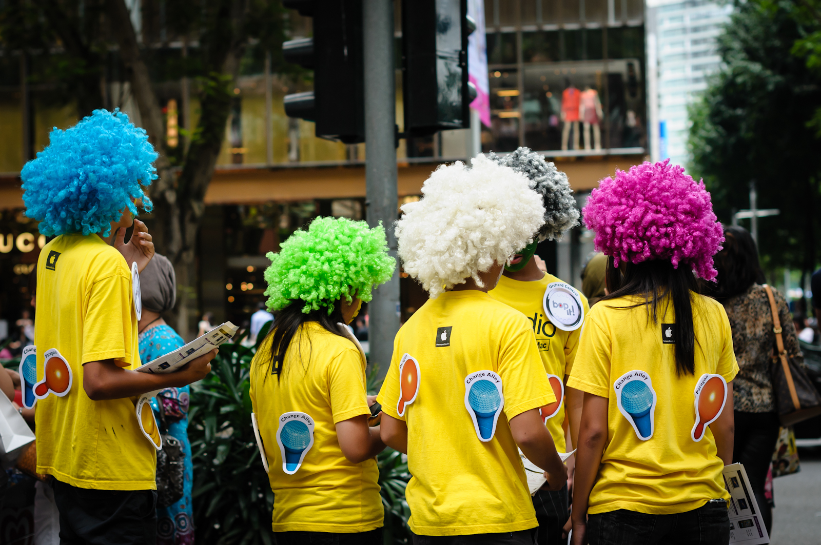 Street photography - iStudio staff in colourful afro wigs