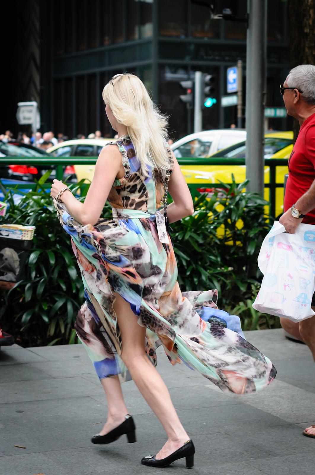 Street photography - Blonde woman in long dress running