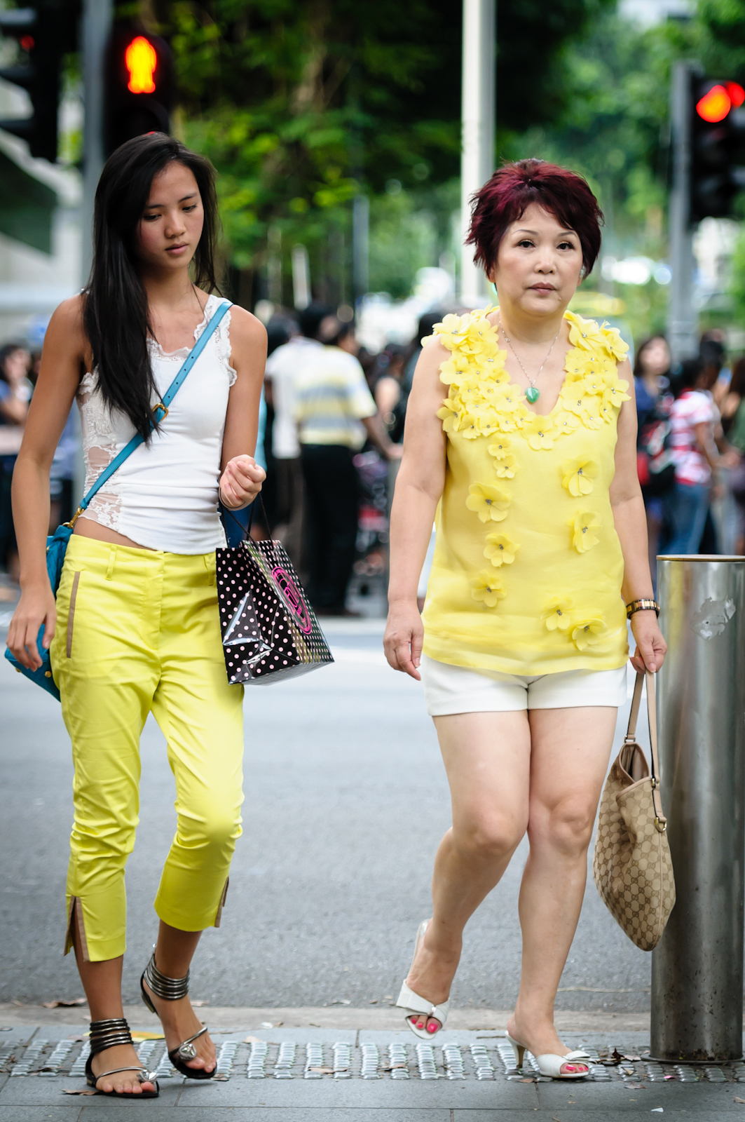 Street photography - Mother and daughter wearing yellow and white
