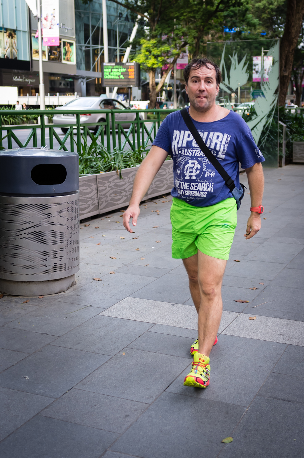 Street photography - Tourist in blue top, green shorts and yellow shoes