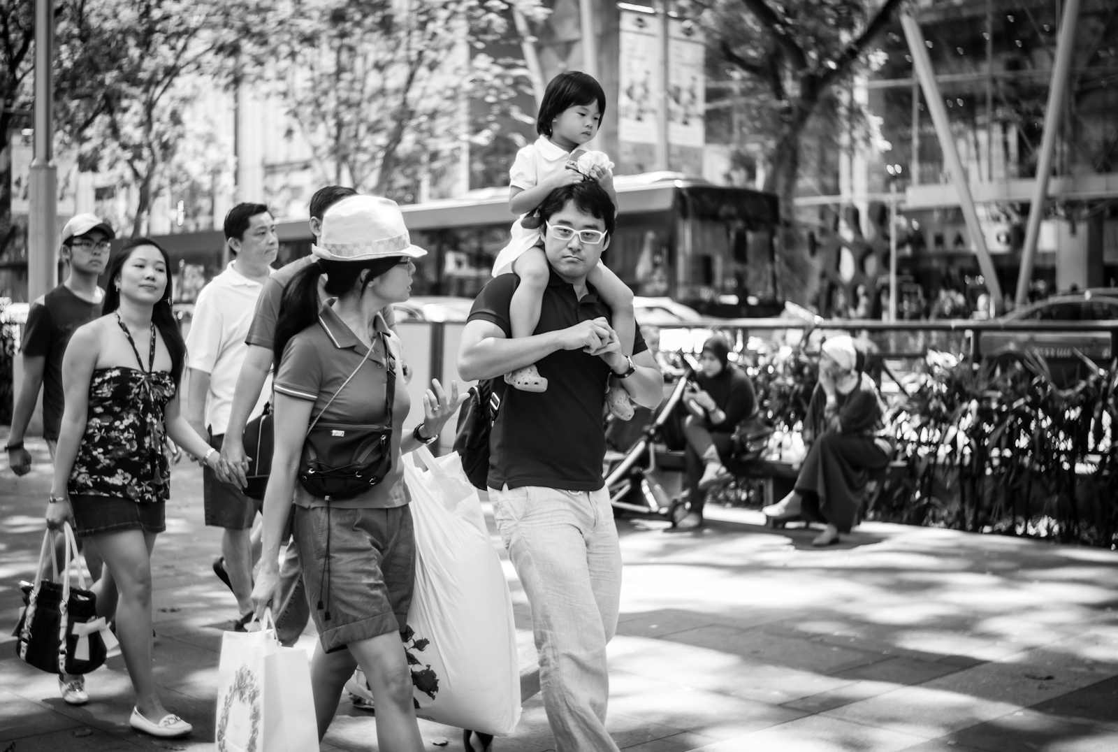 Street photography - family walking along Orchard Road