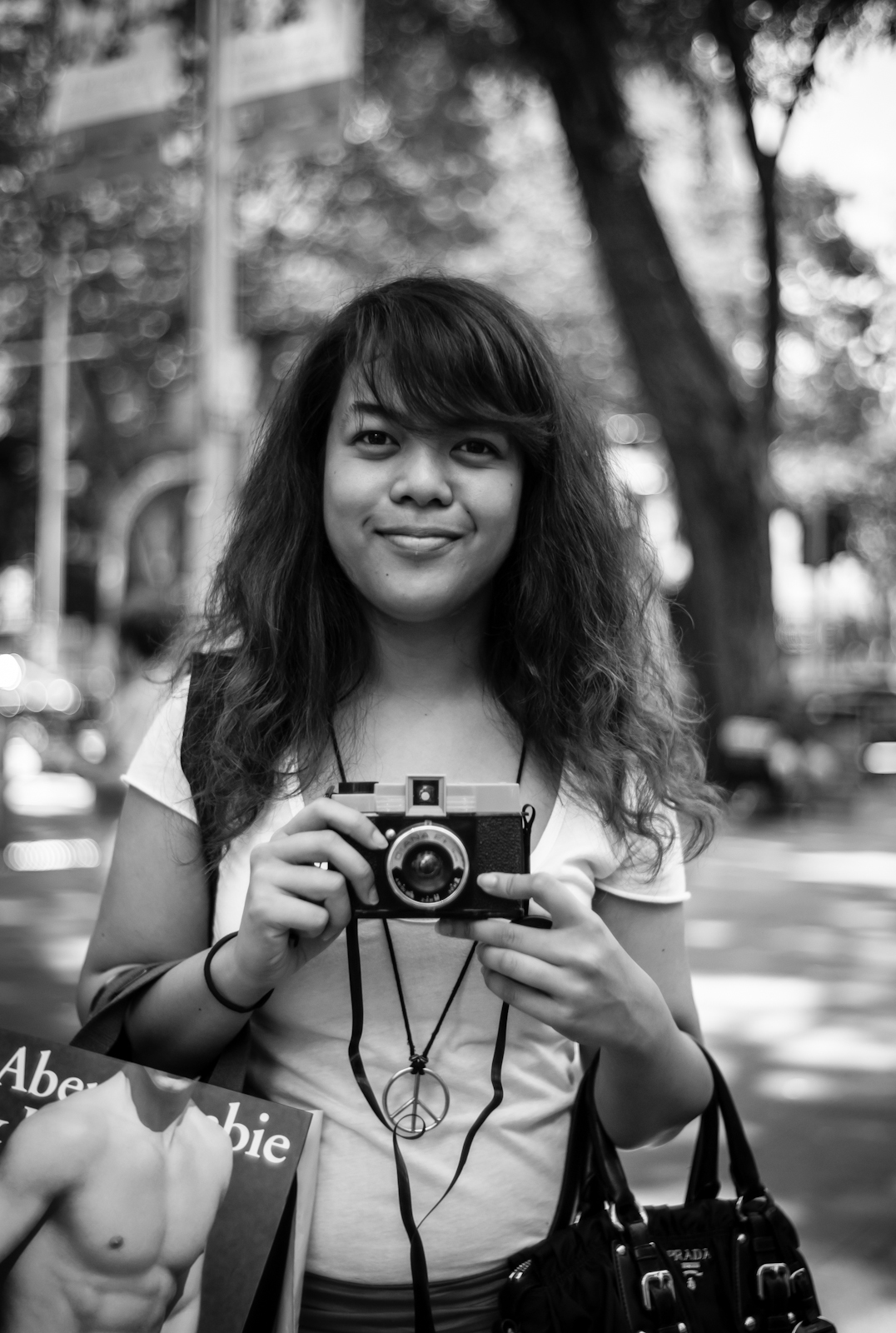 Street photography - girl shooting with a Diana F in Orchard Road