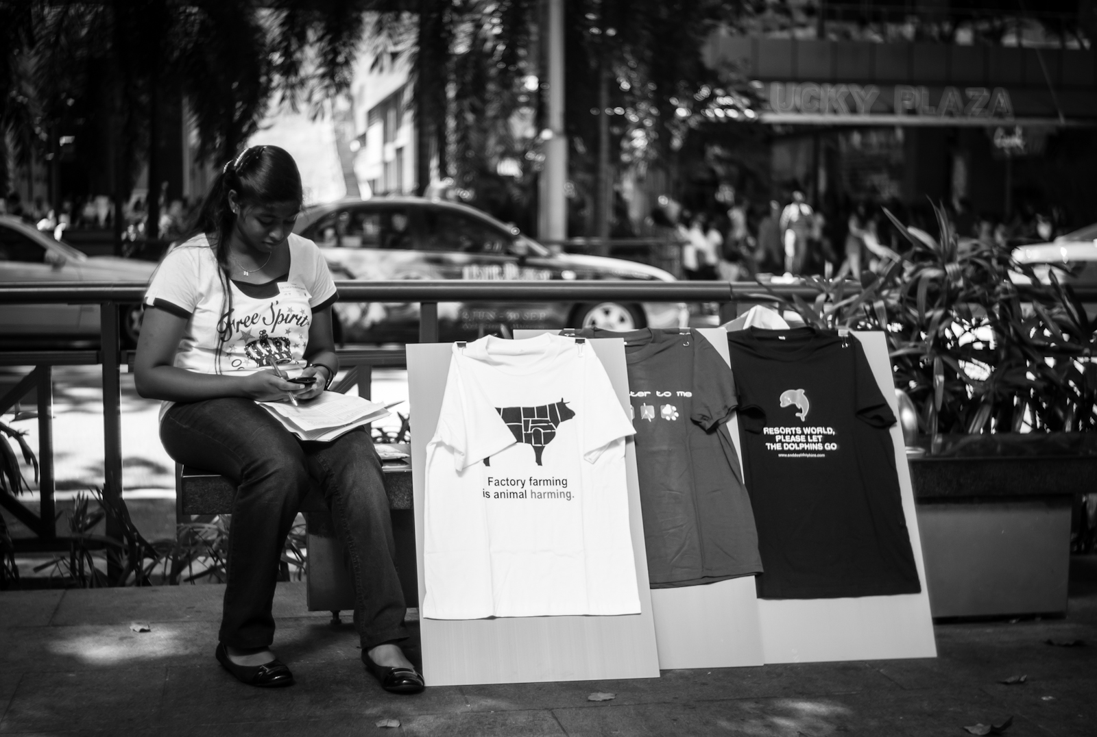 Street photography - girl promoting the green movement in Orchard Road
