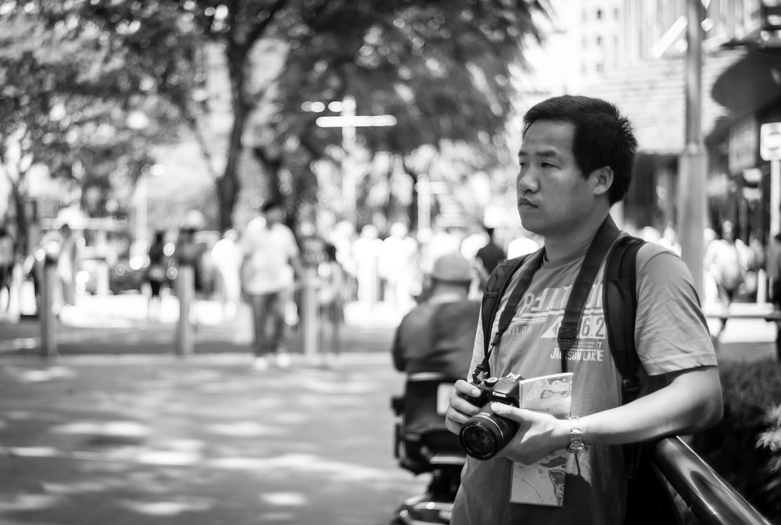 Street photography - tourist photographing in Orchard Road