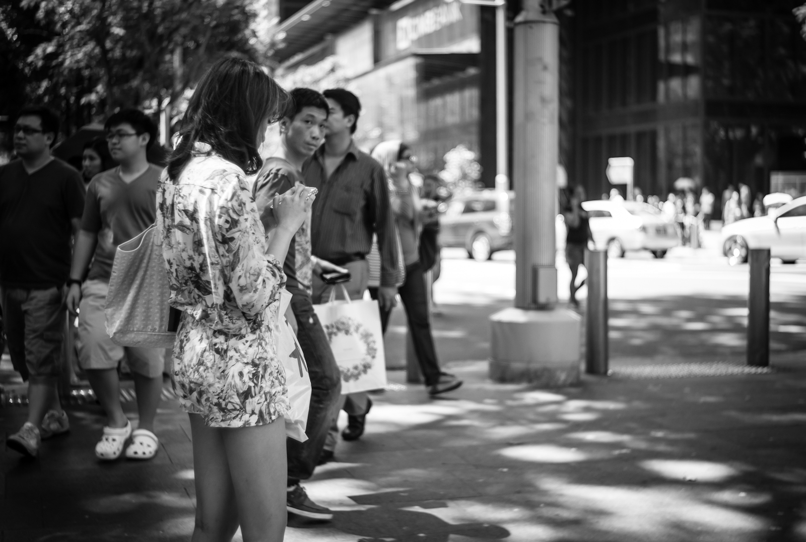 Street photography - girl in floral clothing standing in the middle of the side walk