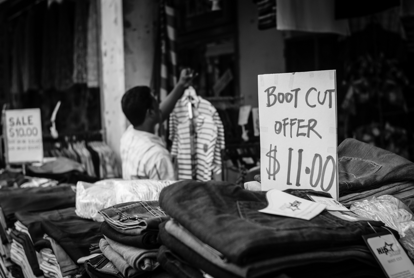 Street photography - Boot cut jeans on sale in Little India