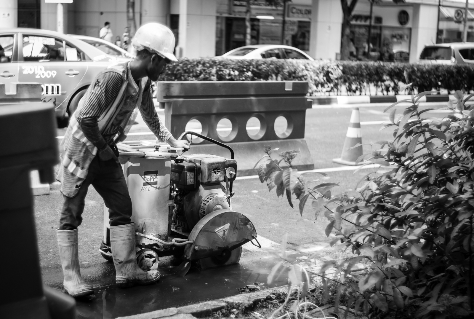 Street photography - Construction worker along the road