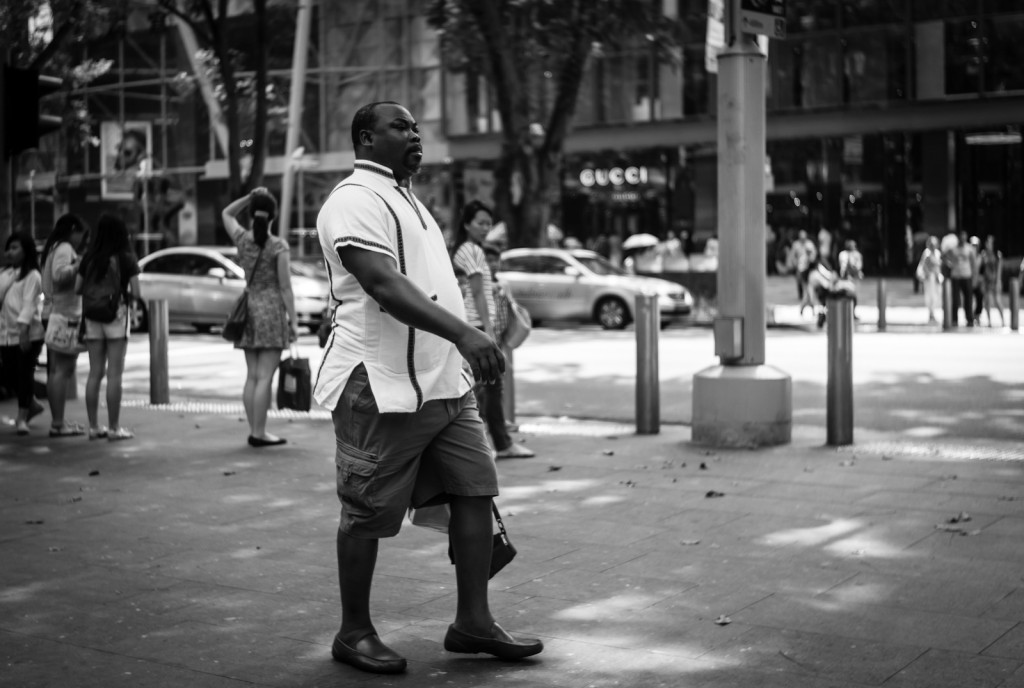 Street photography - Man walking along Orchard Road