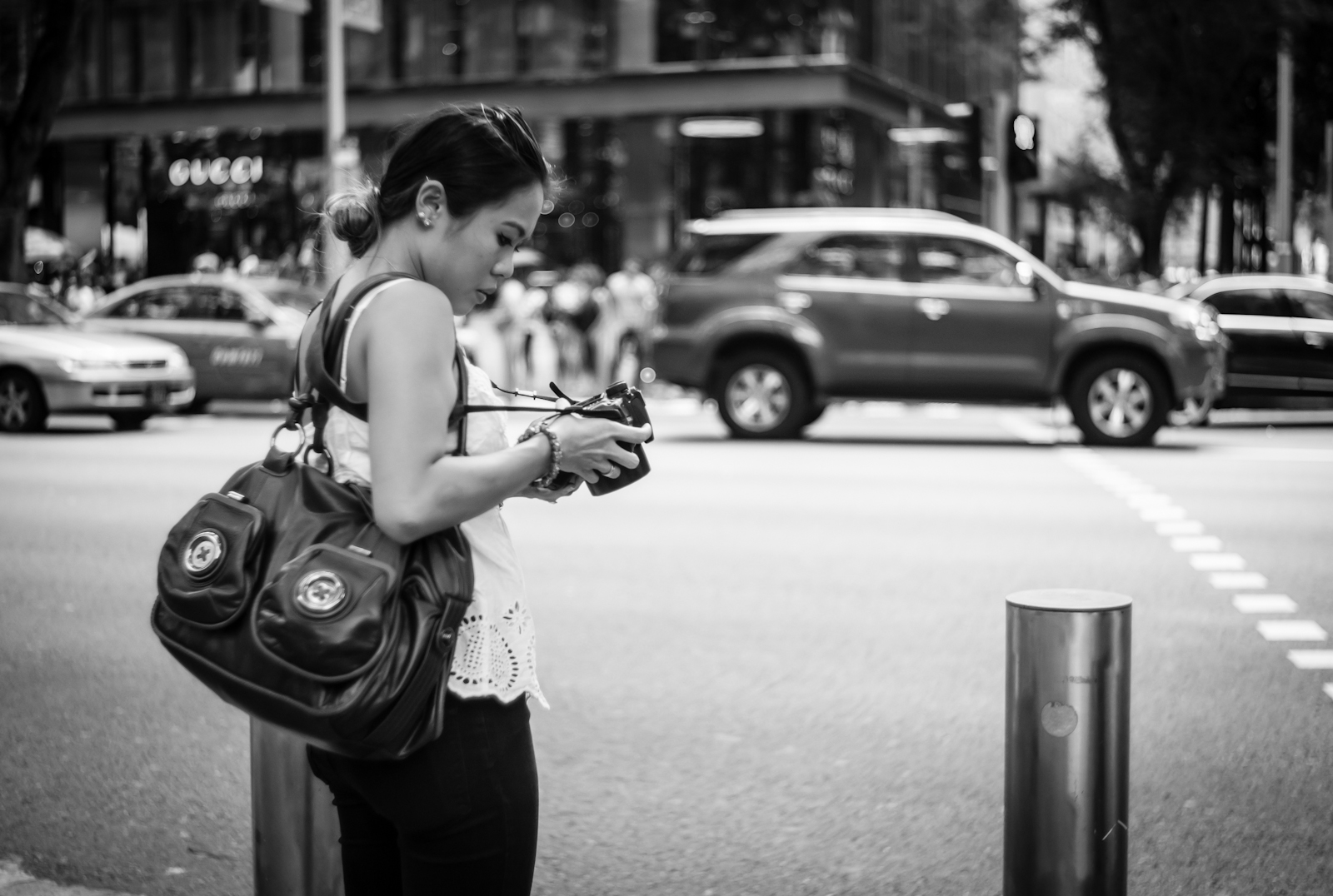 Street photography - Woman with a DSLR camera