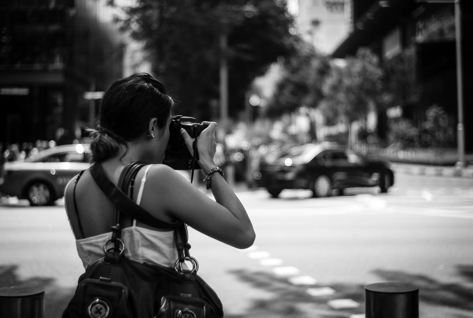 Street photography - Woman shooting with a DSLR camera