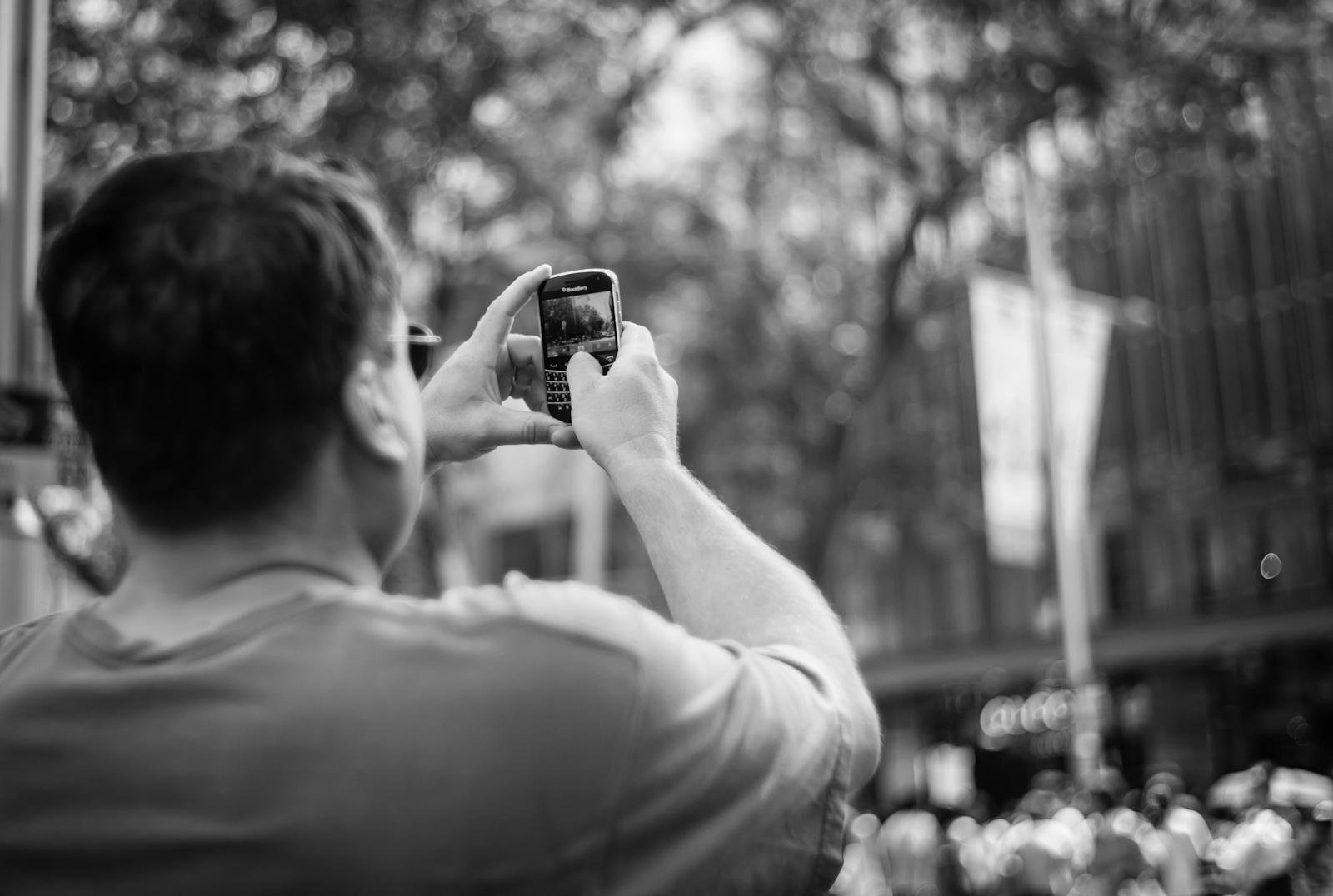 Street photography - Man shooting with his mobile phone