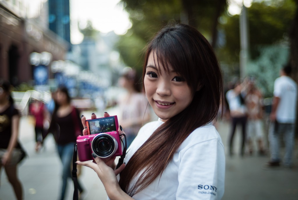 Street photography - Girl promoting Sony NEX camera