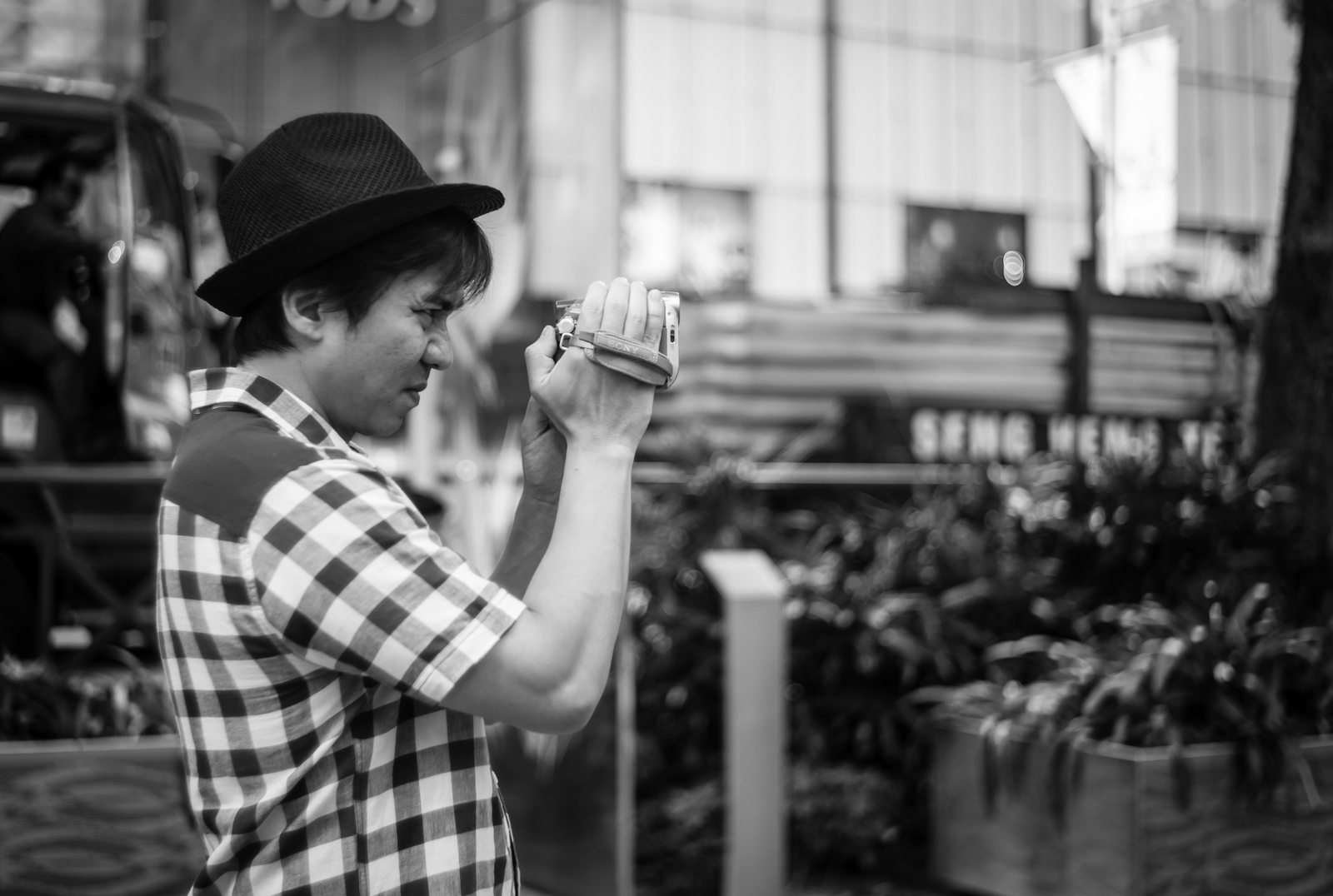 Street photography - Tourist taking a video along Orchard Road