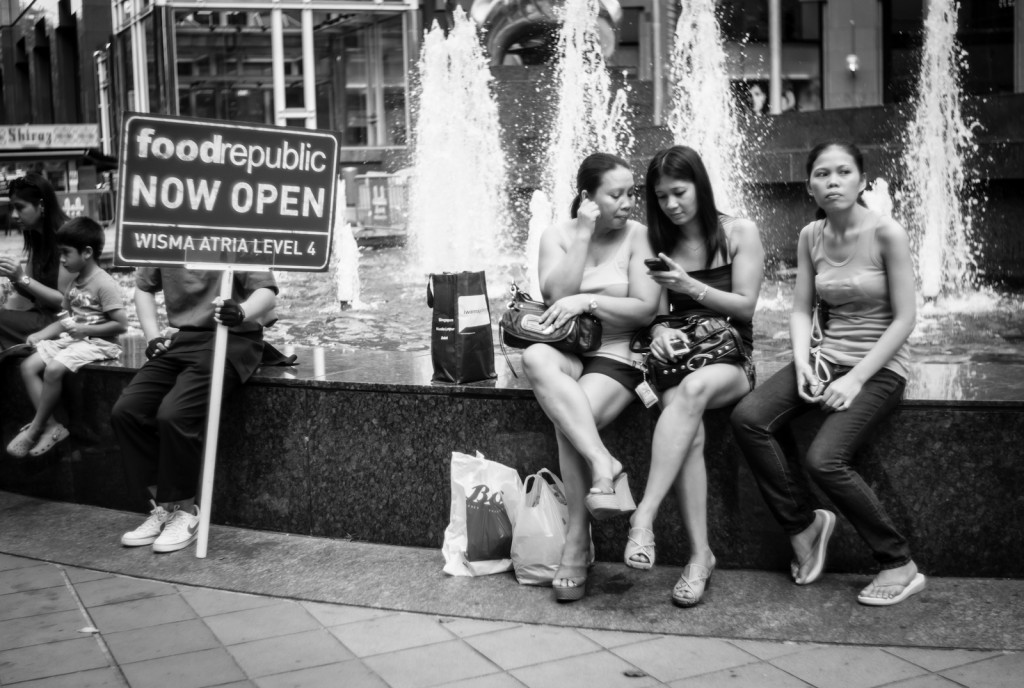 Street photography - People resting at the Ngee Ann City fountain