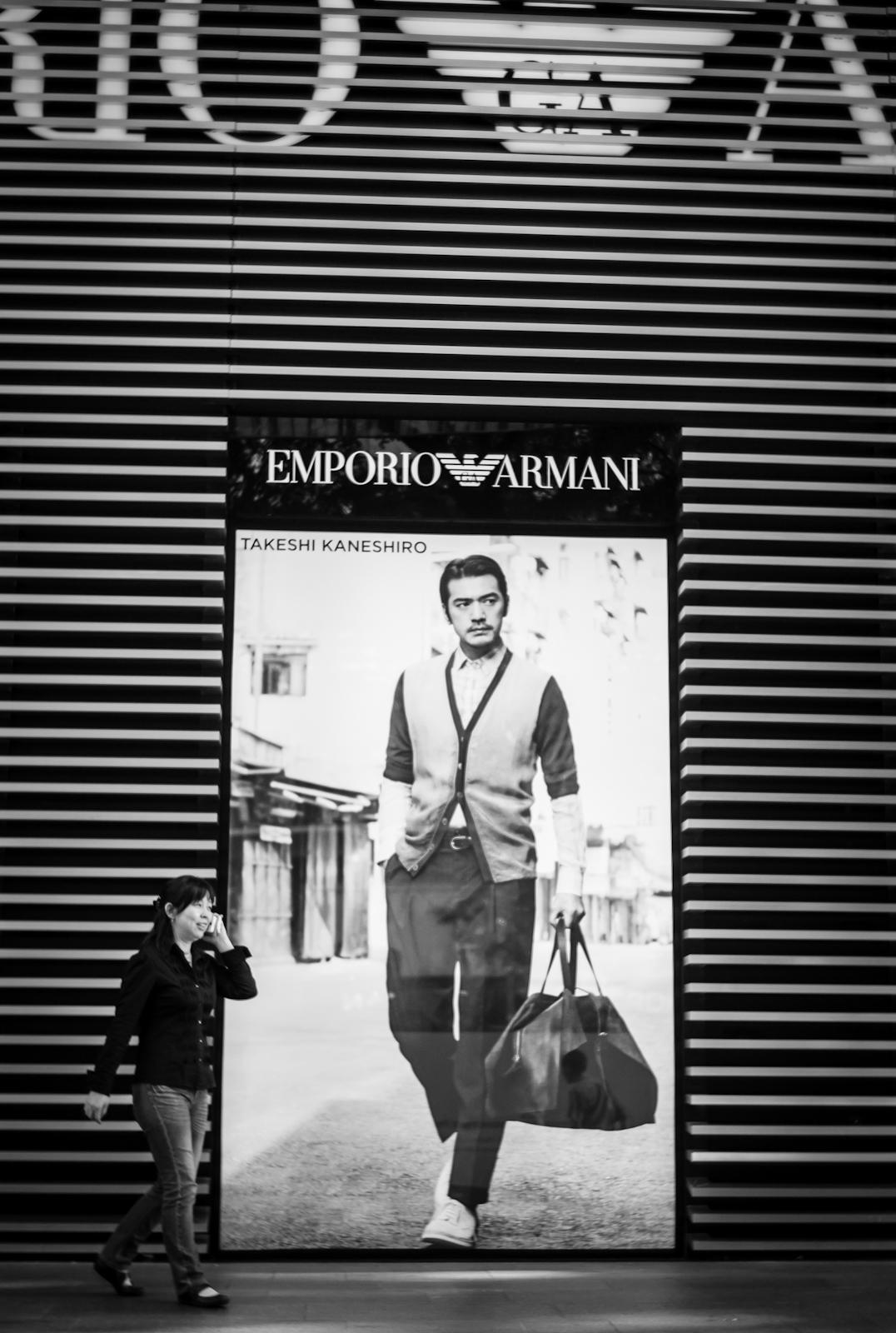 Street photography - Woman walking in front of Emporio Armani
