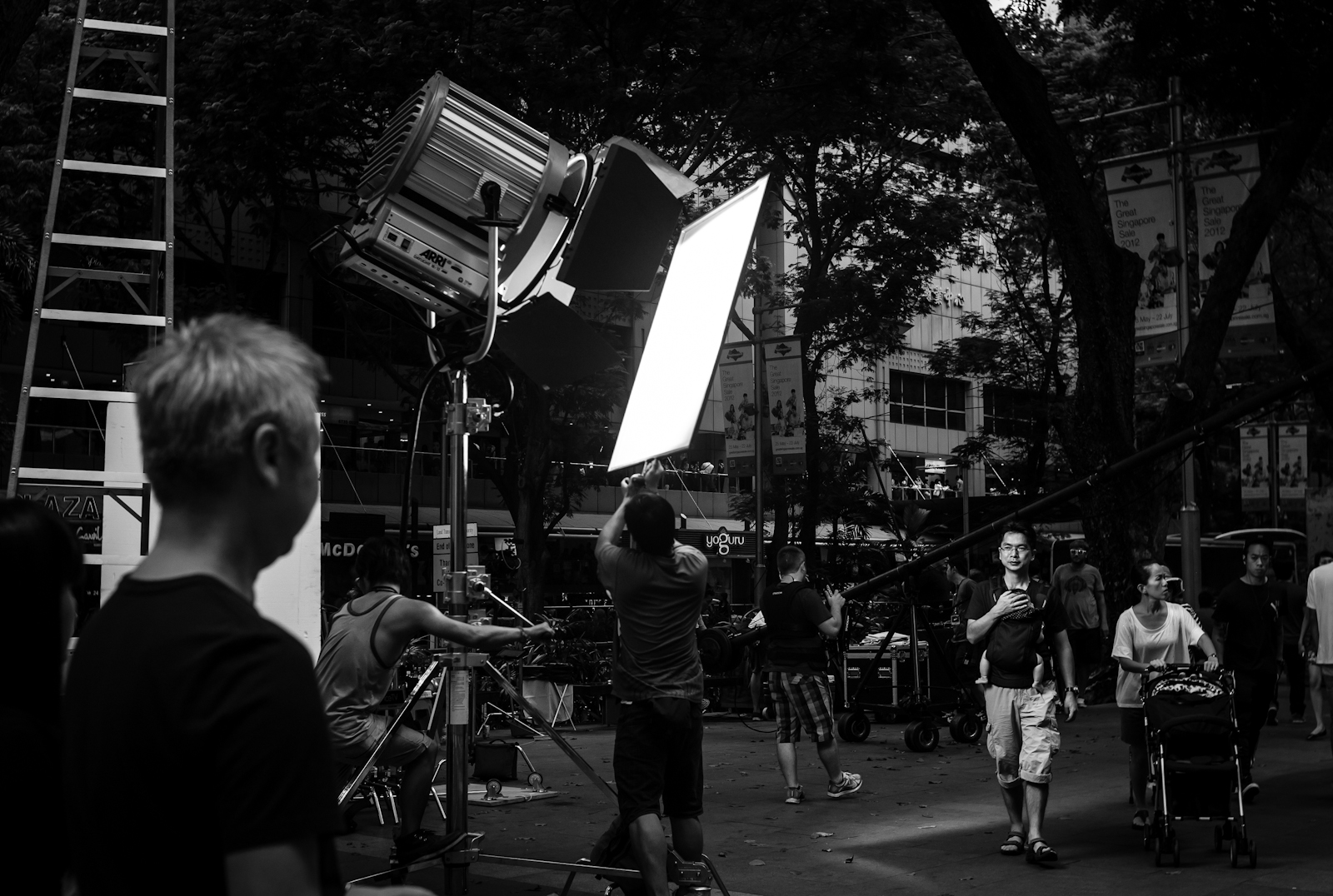 Crew setting up lighting for a fashion runway along Orchard Road