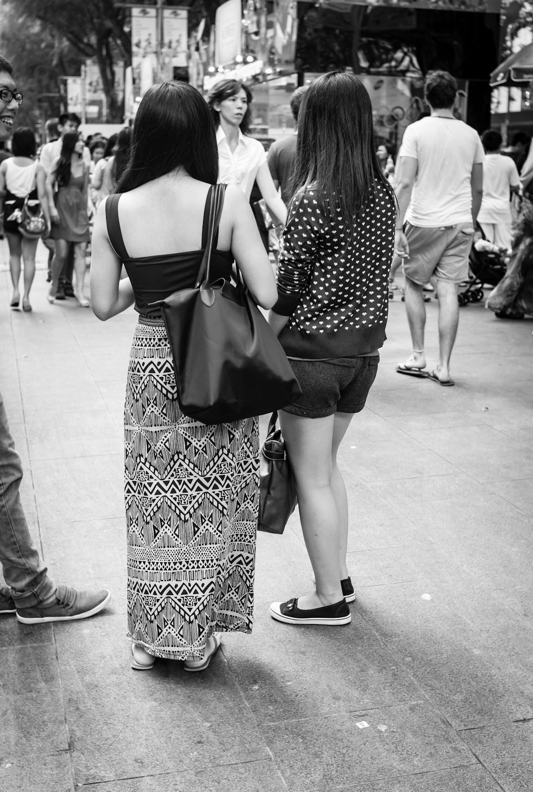 Girl in sleeveless top and long dress, and a girl in long-sleeved top and shorts