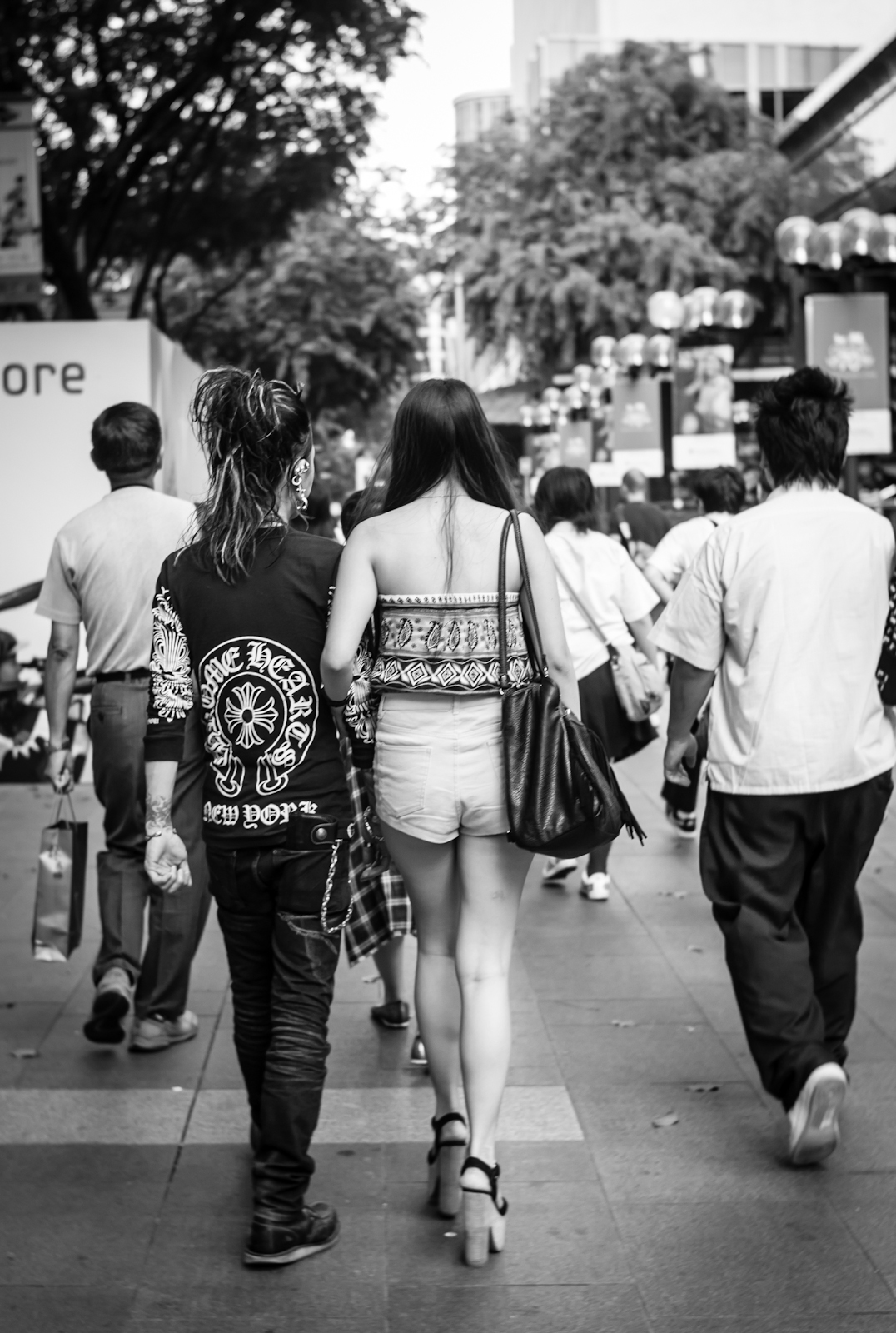 Couple in trendy fashion along Orchard Road