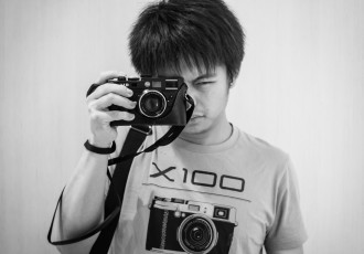 Self portrait of photographer wearing Fujifilm X100 t-shirt from Uniqlo