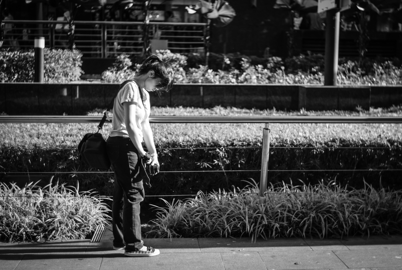 Photographer shooting along Orchard Road
