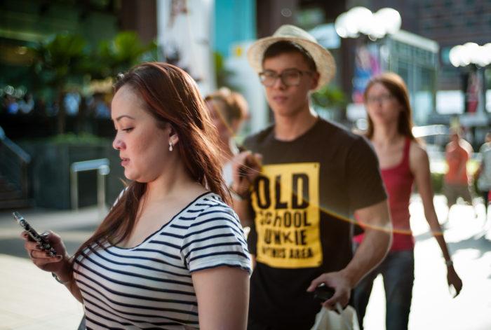 Pedestrians looking over each other's shoulders