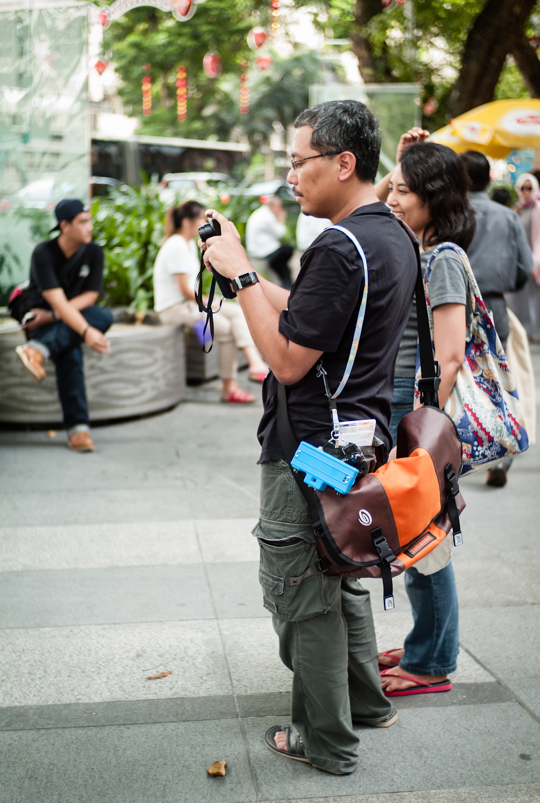 A man with cameras dangling from his bag