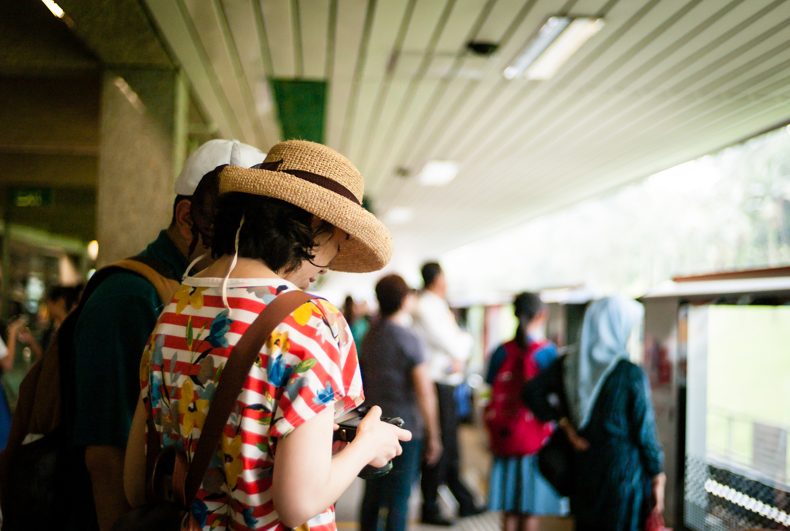 Tourists in the Ang Mo Kio MRT station in SIngapore
