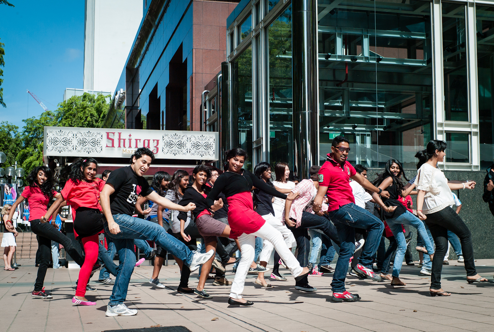 A group of Indian dancers in a flash mob along Orchard Road