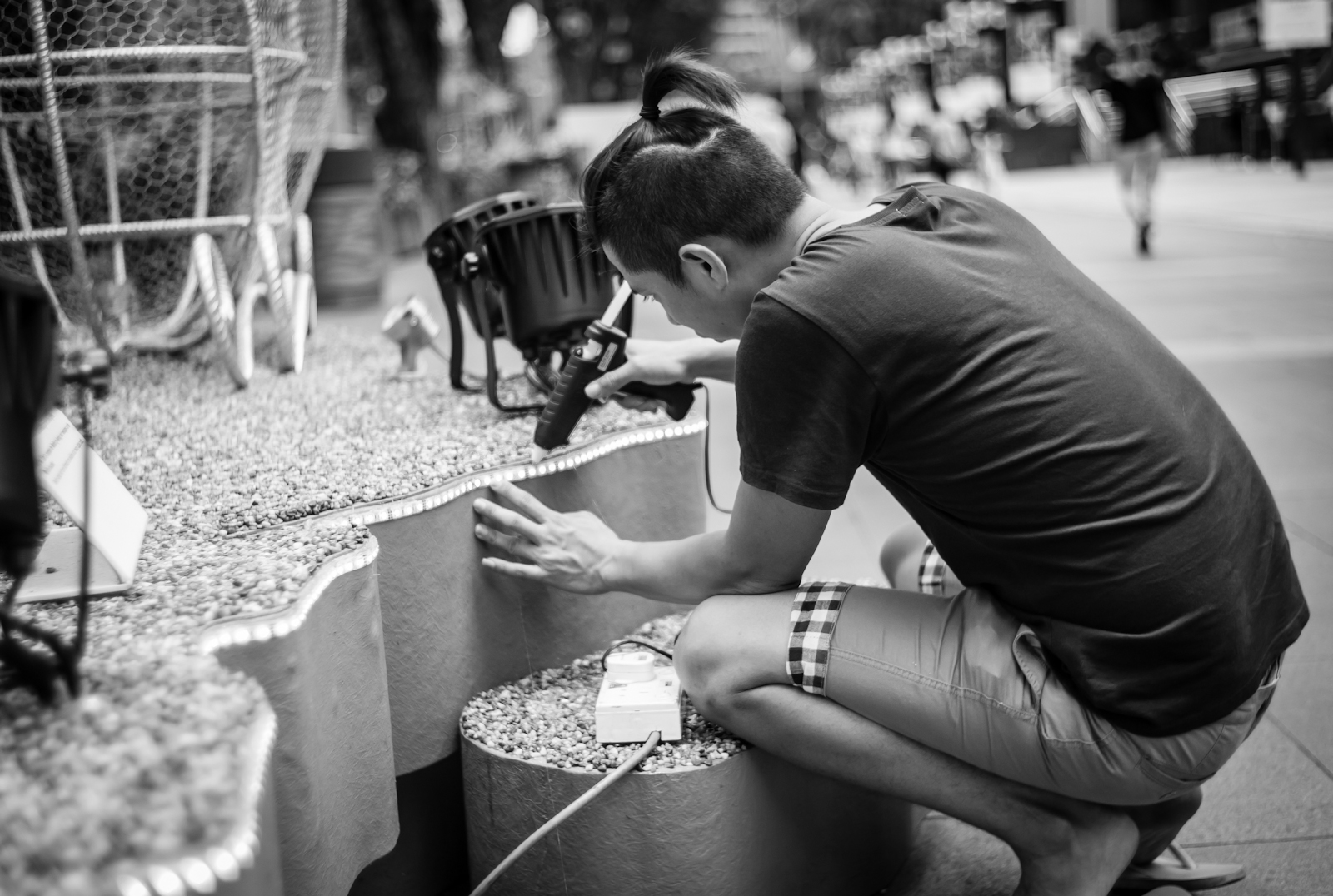 A man setting up decorations along Orchard Road