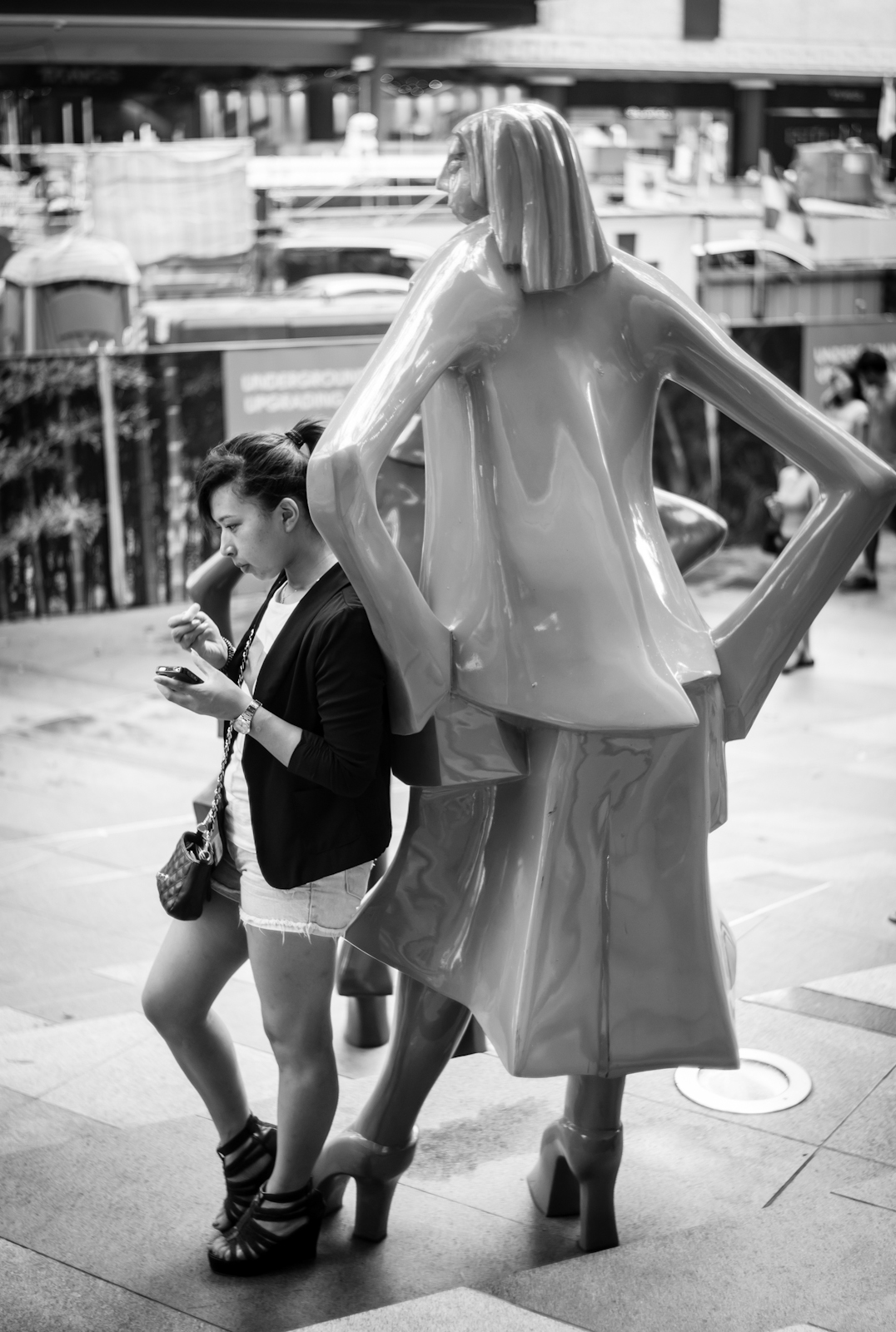 Tourist with a statue in Orchard Road
