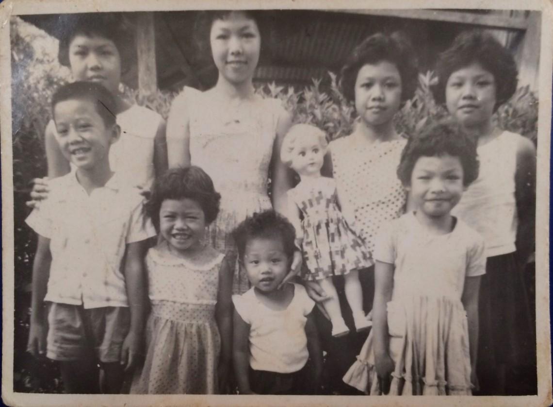 Polaroid photo of siblings