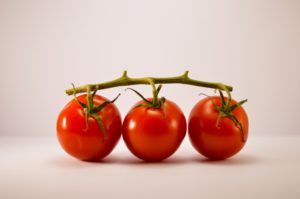 three cherry tomatoes